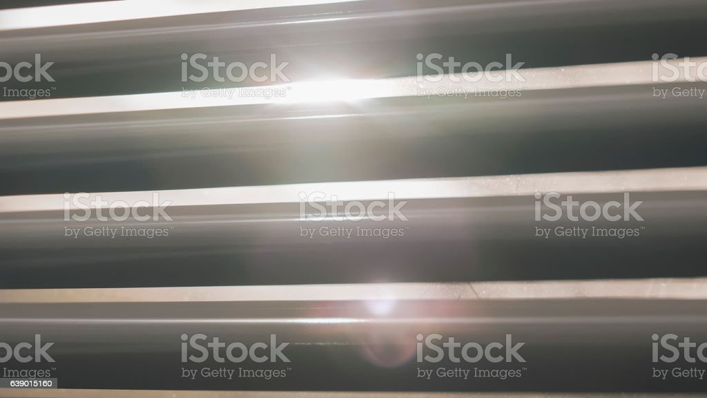 Sun lights shining through the blinds stock photo