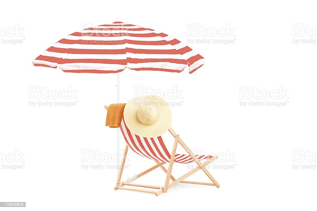 Sun lounger with stripes and umbrella stock photo