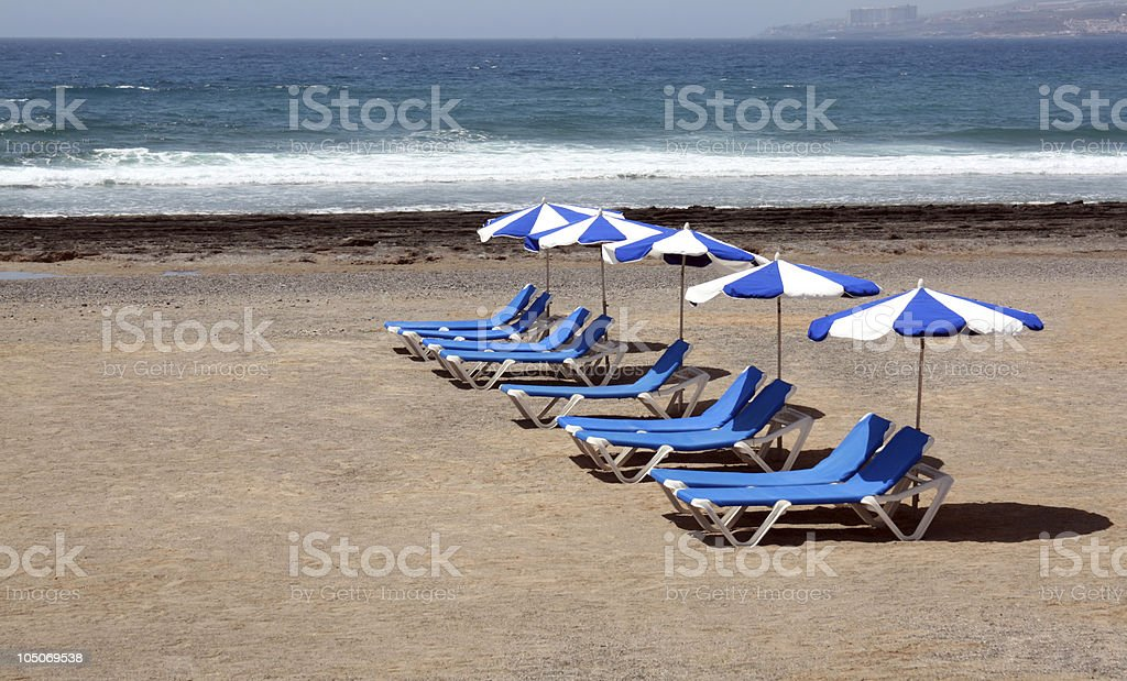 Sun Loungers and Parasols stock photo