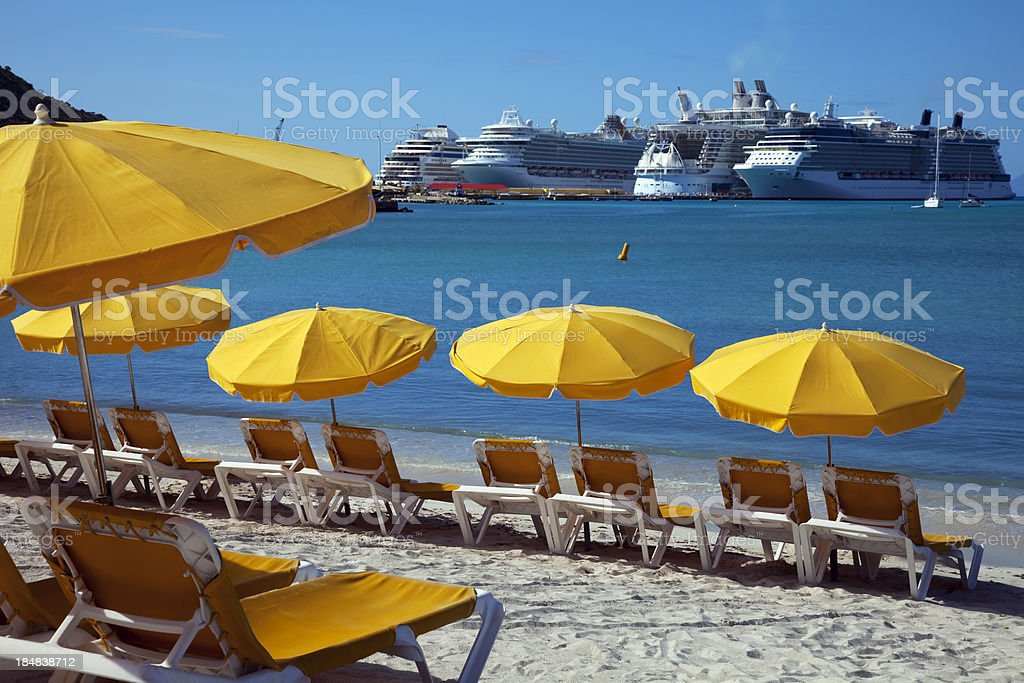 Sun loungers and sunshades on the beach stock photo