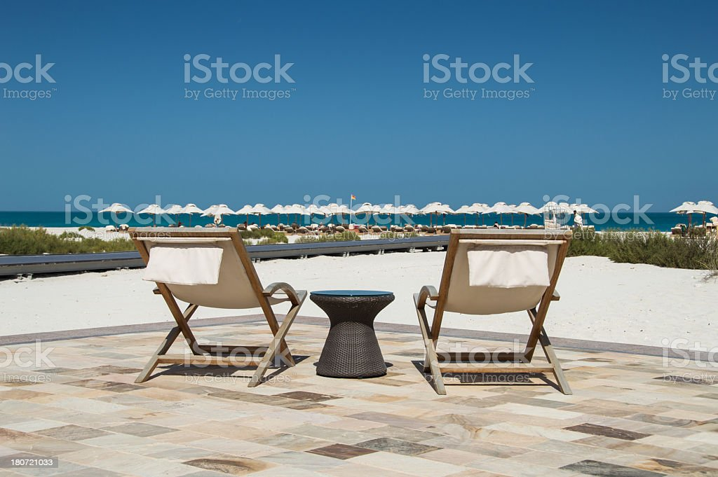Sun loungers at the beach royalty-free stock photo