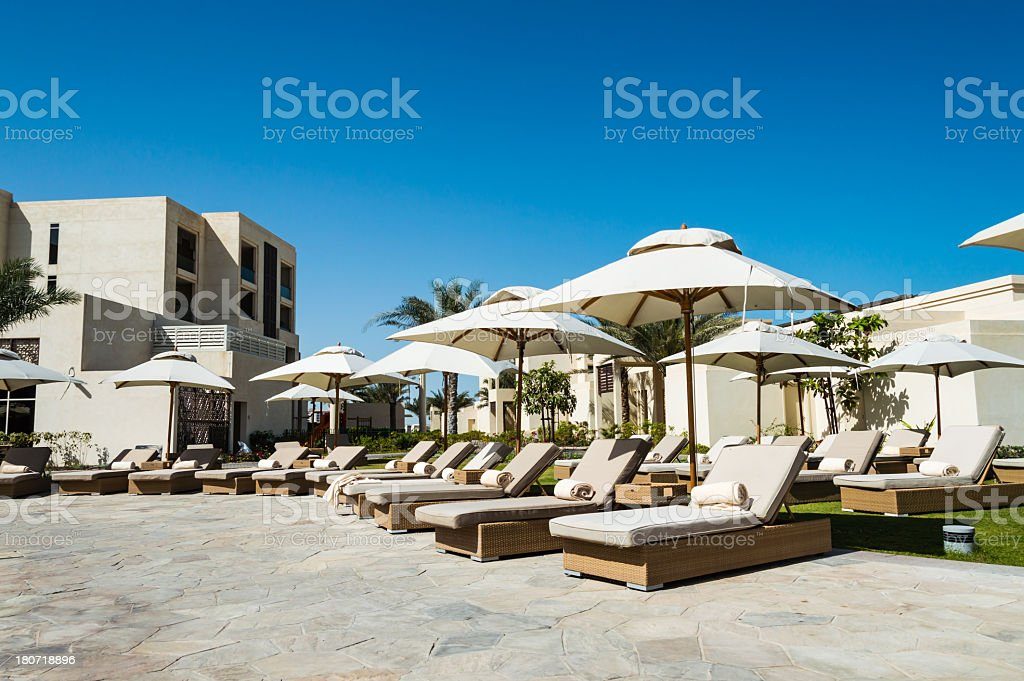 Sun loungers at the pool royalty-free stock photo