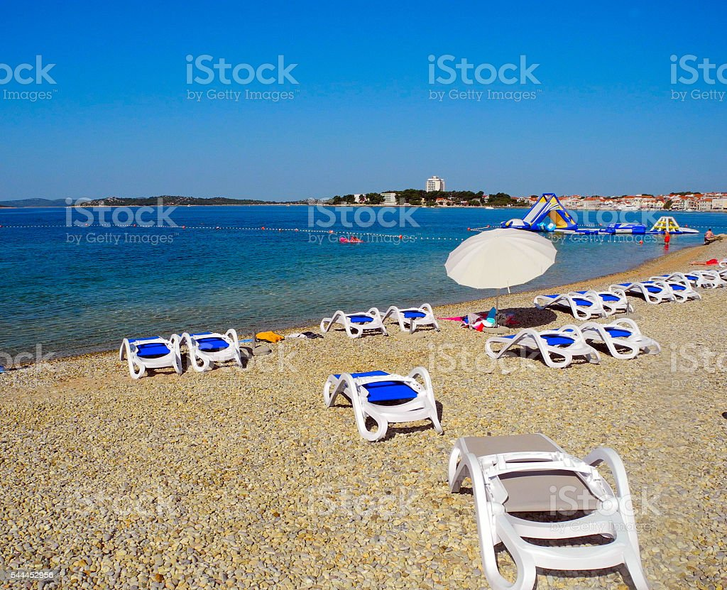 Sun loungers on the beach in Vodice. stock photo