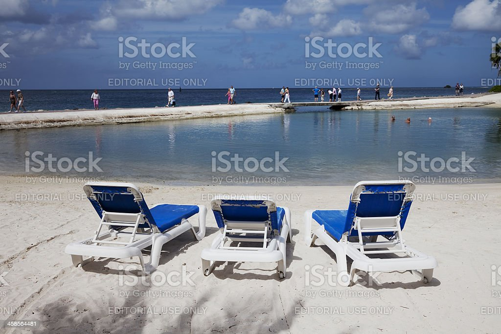 Sun loungers on the beach stock photo