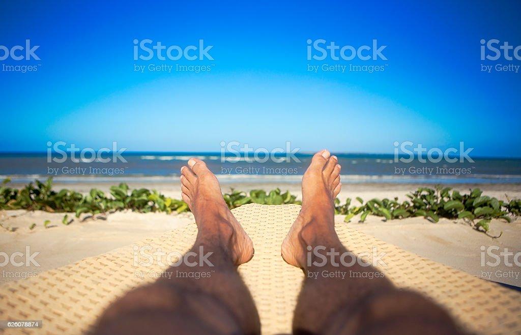 sun near ocean men stock photo