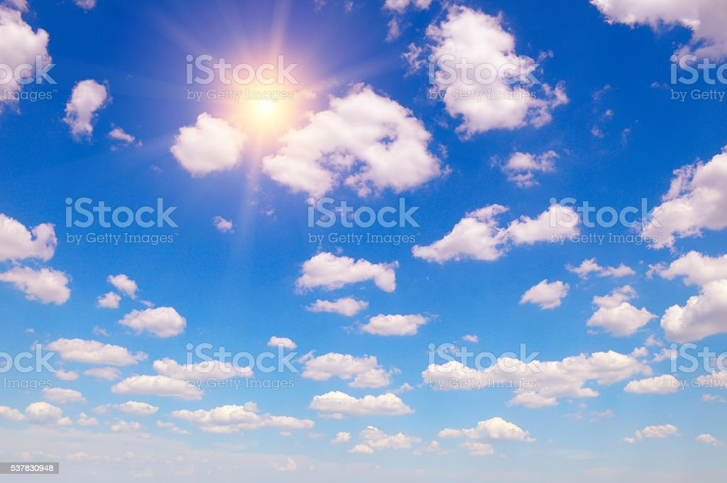 sun on blue sky and white clouds stock photo