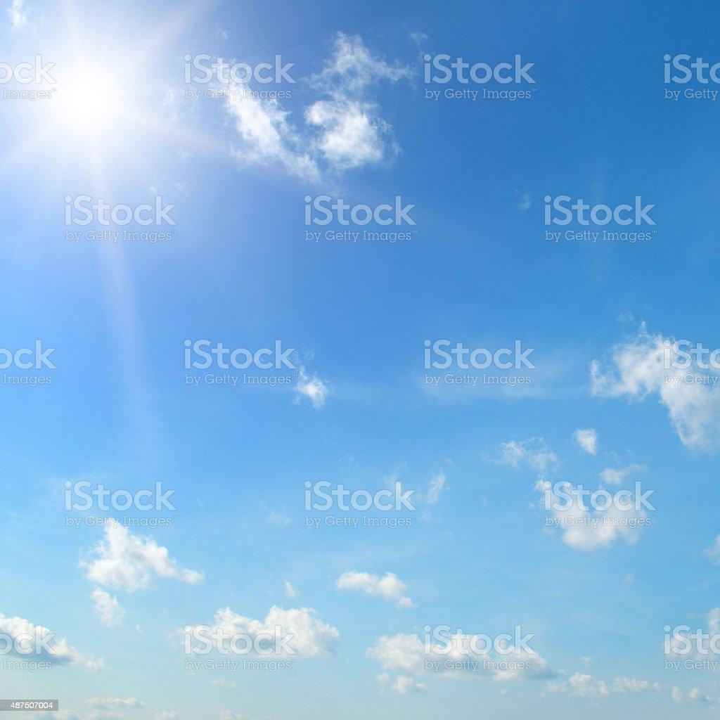 sun on blue sky stock photo