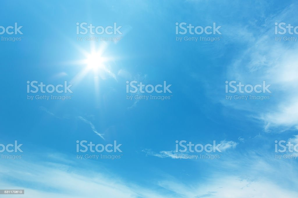 sun on blue sky stock photo