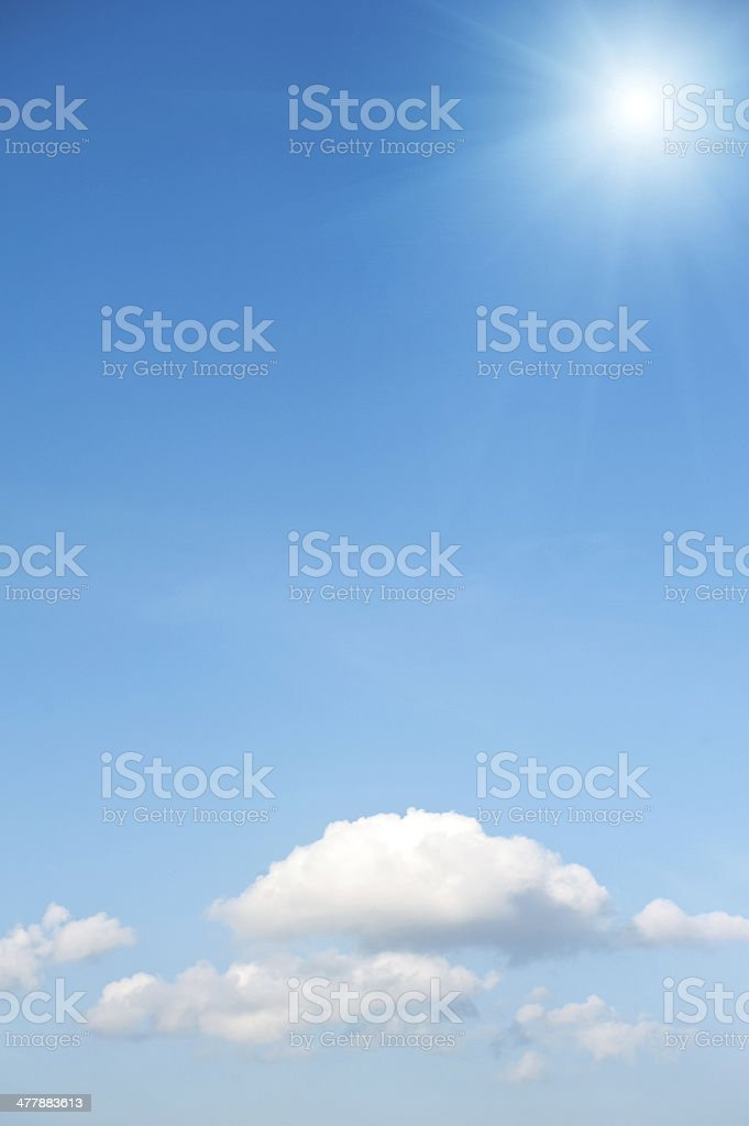 Sun on blue sky with clouds. royalty-free stock photo