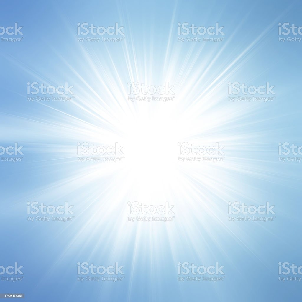 Sun on blue sky with lenses flare stock photo