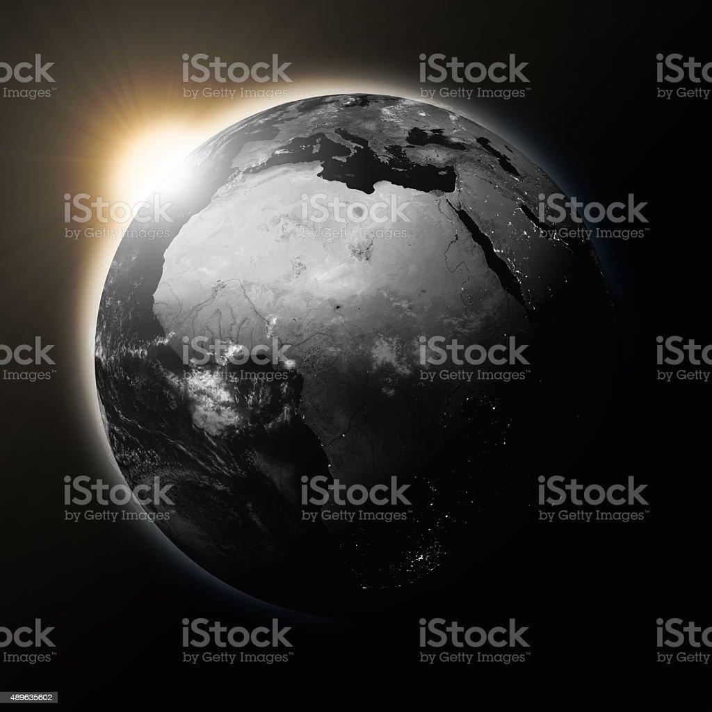 Sun over Africa on dark planet Earth stock photo