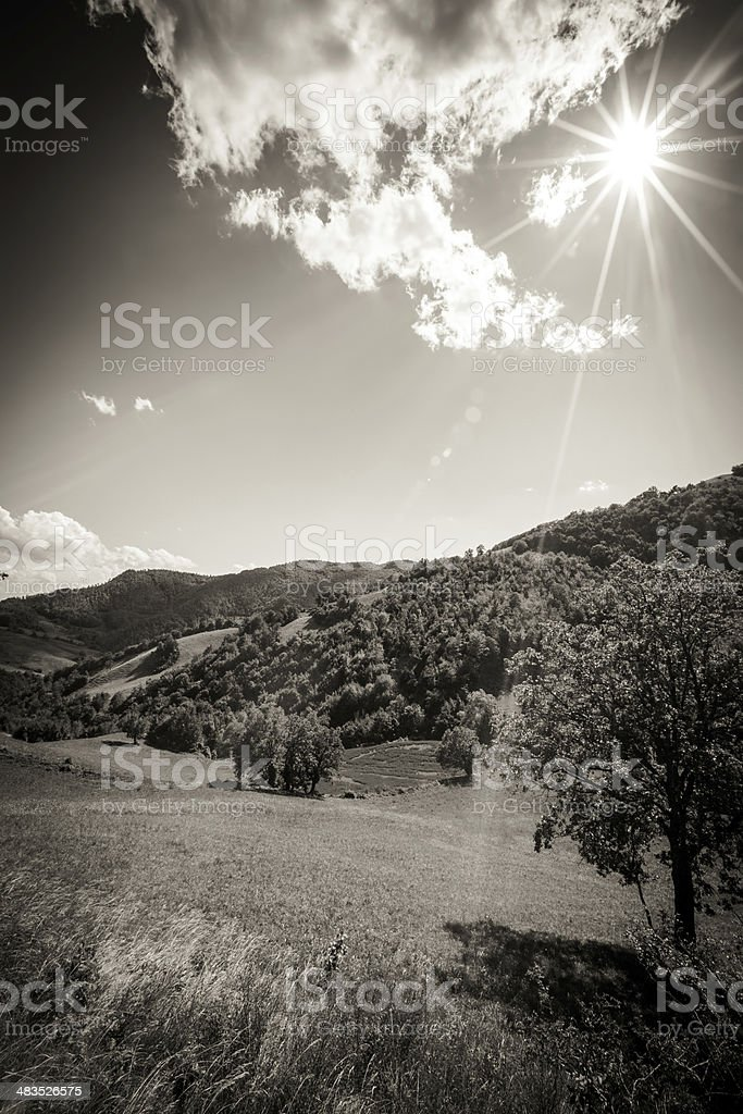 Sun over forests and mountains, Italy royalty-free stock photo