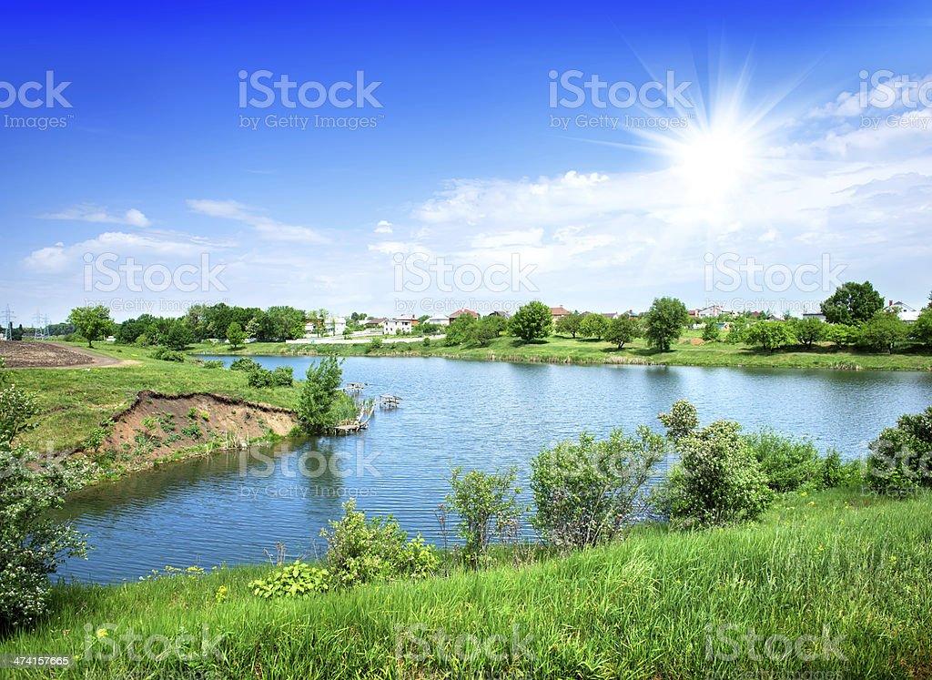 Sun over river stock photo