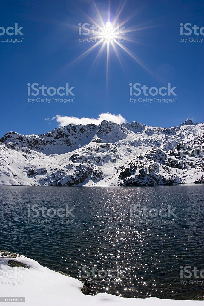 sun over snowy mountain royalty-free stock photo