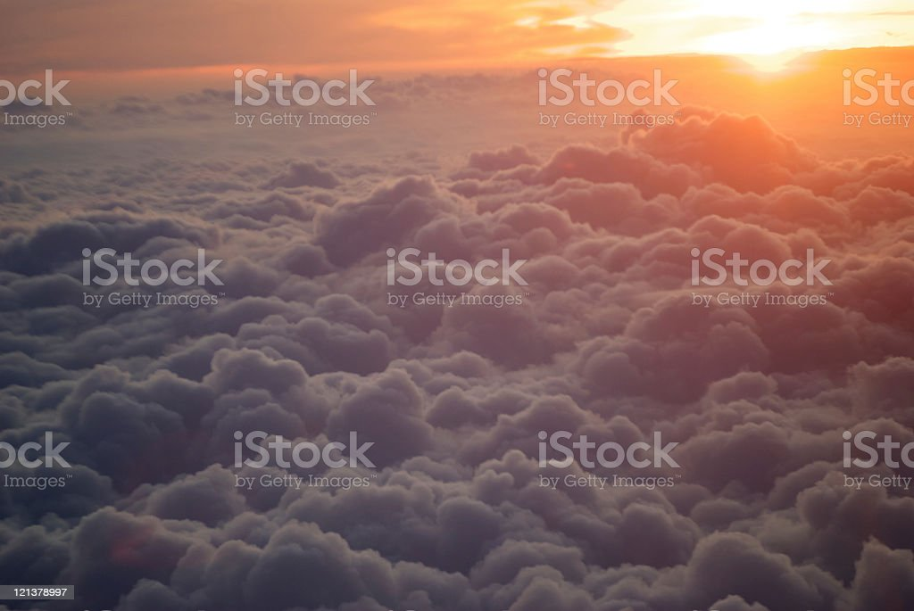 Sun over the clouds stock photo