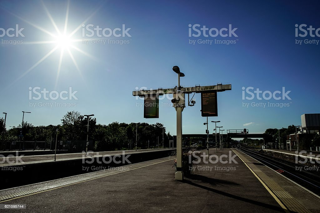 Sun over train station stock photo