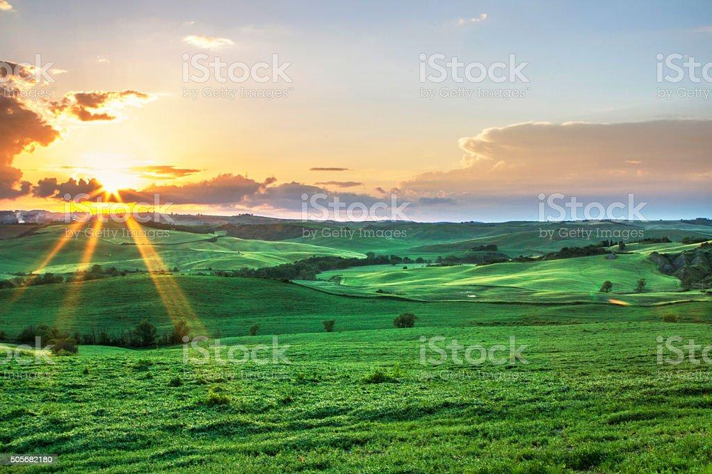 Sun over Tuscany plains stock photo