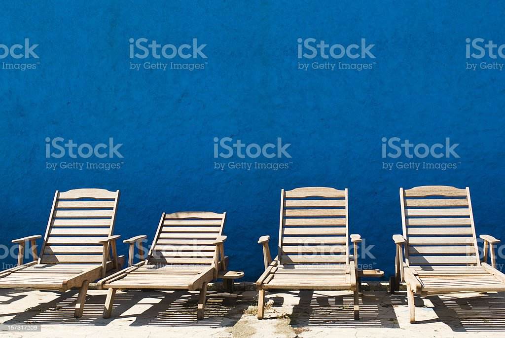 Sun Patio with four Deck Chairs stock photo