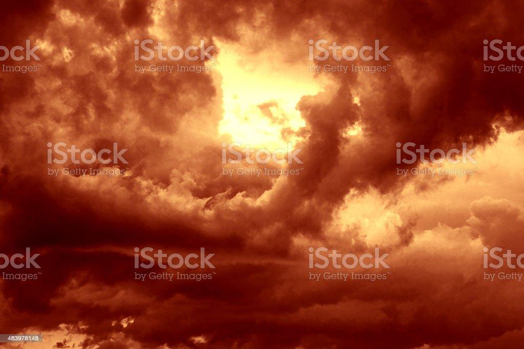 Sun Peaking Through Creepy Clouds stock photo