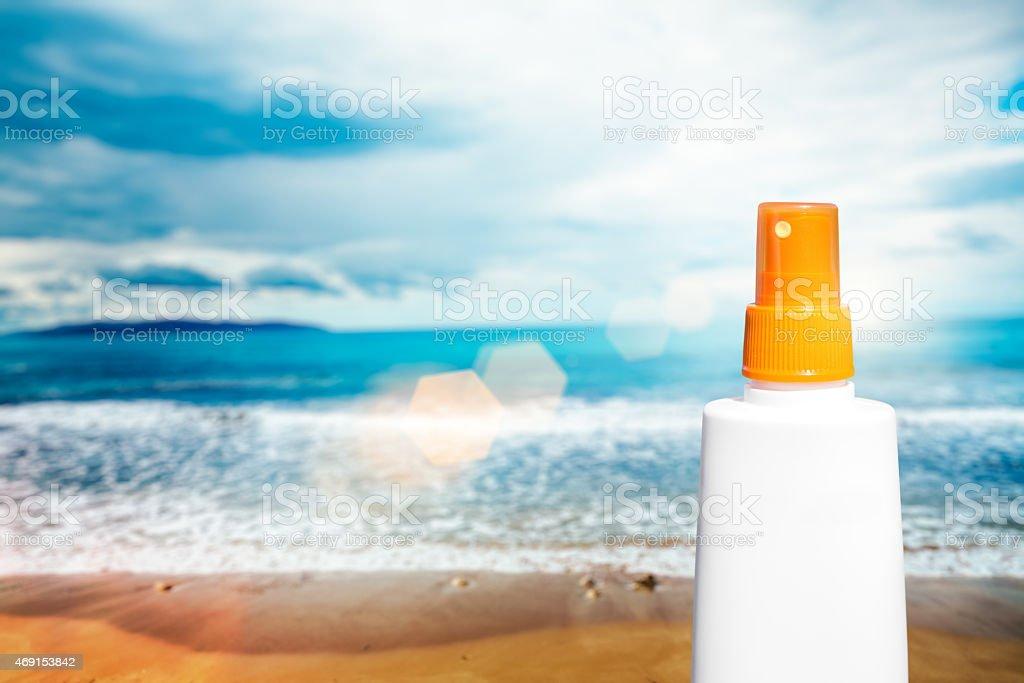 Sun Protection Cream Bottle On The Beach stock photo