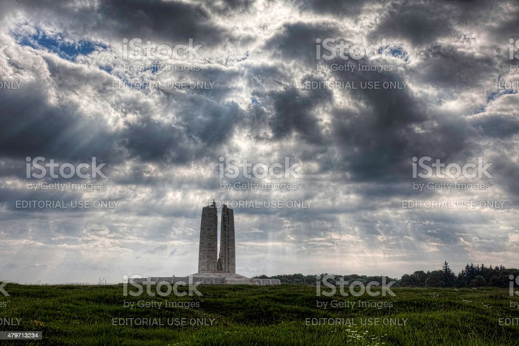Sun rays break through clouds at the Vimy Memorial, France. stock photo