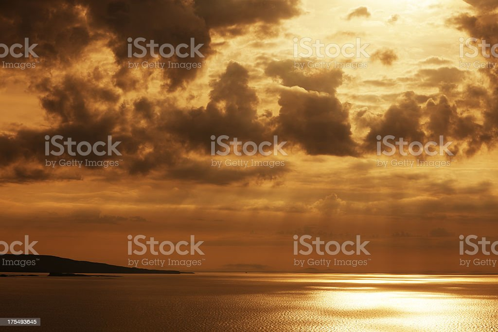 Sun Rays Breaking Through Clouds Over Sea, Scotland, UK royalty-free stock photo
