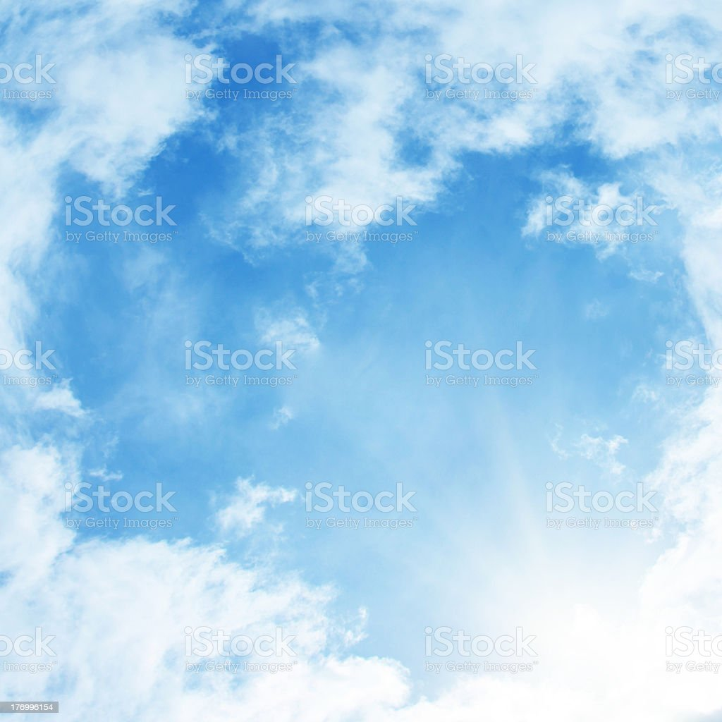 Sun rays in blue sky. stock photo