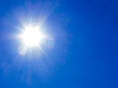 Sun rays on blue sky