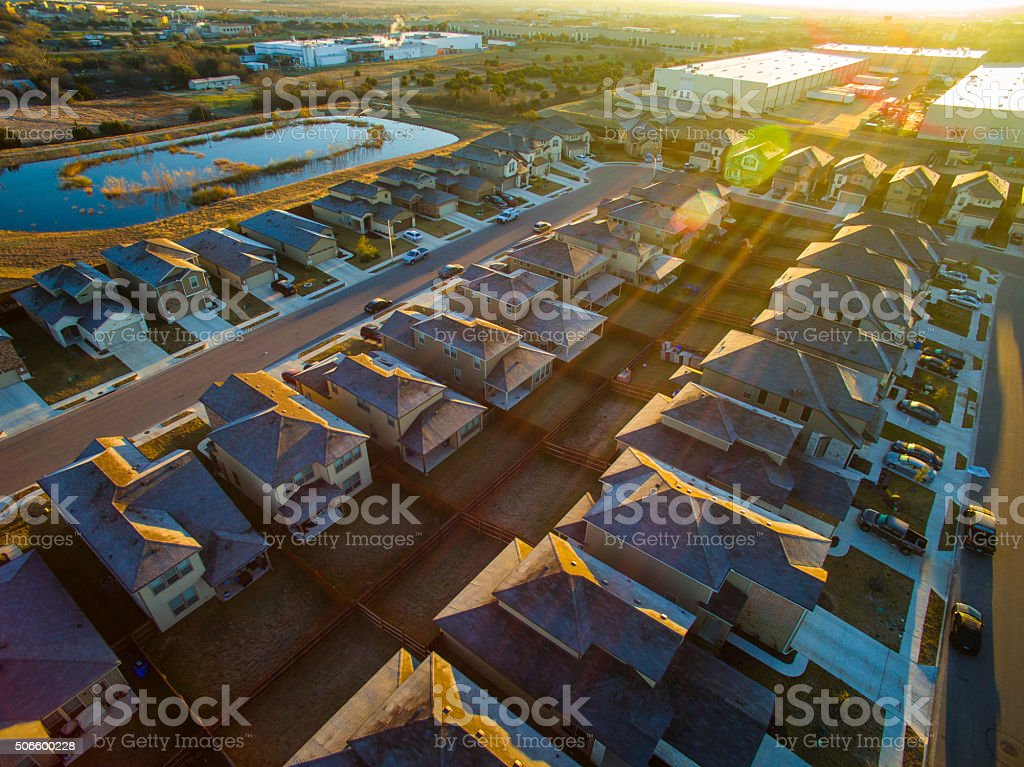 Sun rays over Austin Texas Suburbia House Community stock photo