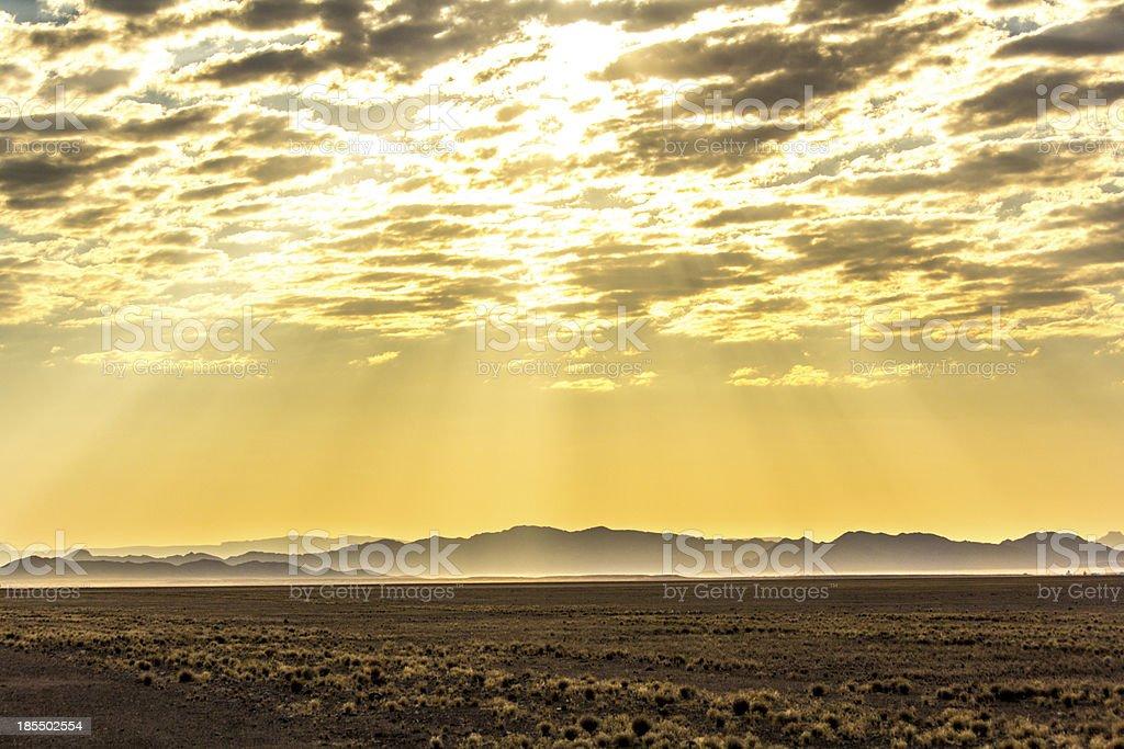 Sun rays over horizon stock photo