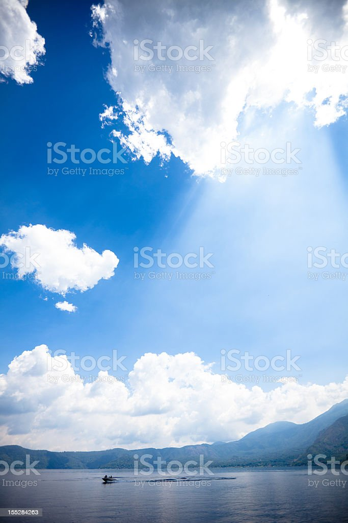 Sun Rays over Lago de Coatepeque (Crater lake) El Salvador stock photo