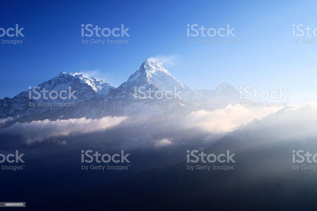 Sun Rays over Snow capped mountain Machapuchare, Annapurna Himalaya stock photo