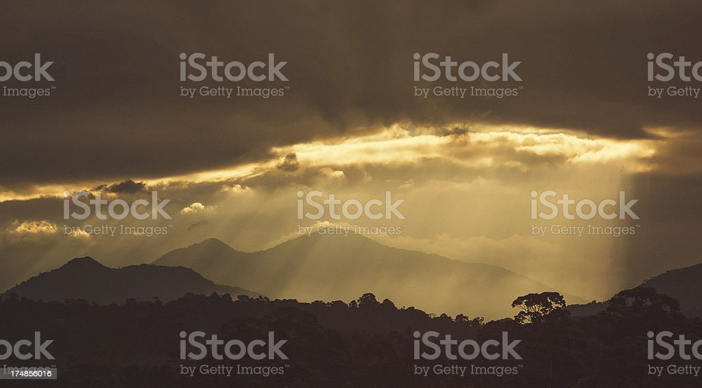 sun rays over the mountains in honduras royalty-free stock photo