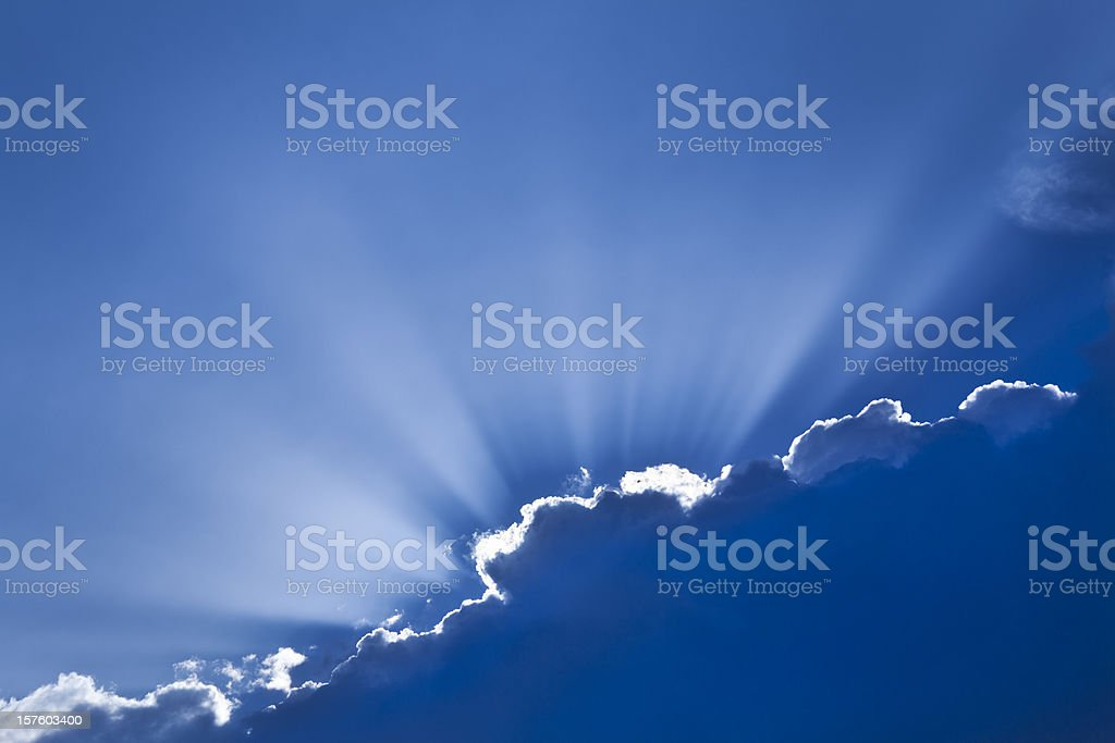 Sun rays peeking out from behind clouds, exemplifying hope royalty-free stock photo