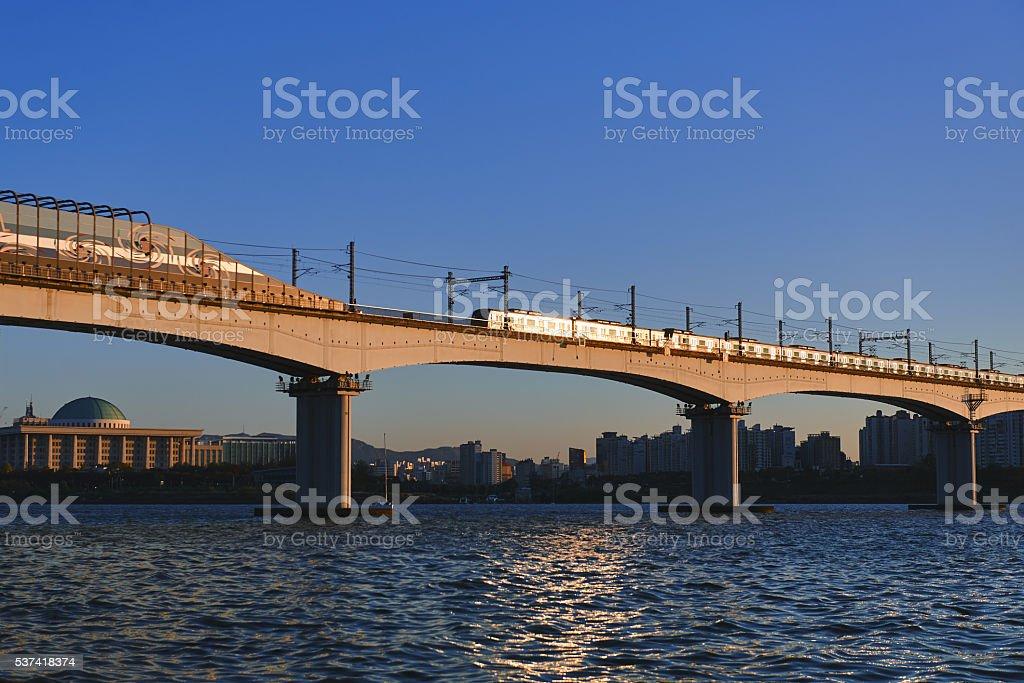 Sun reflected on train on the bridge stock photo