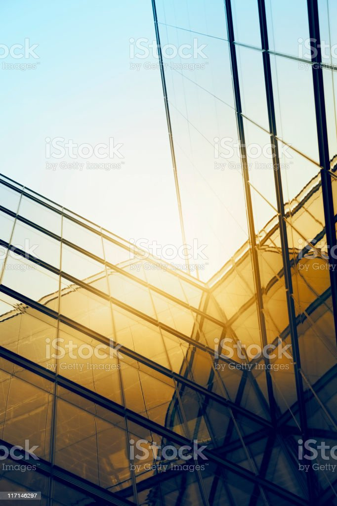Sun reflecting off the exterior of a modern glass building stock photo