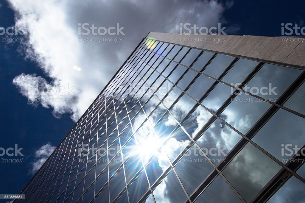 Sun reflecting on office building. stock photo