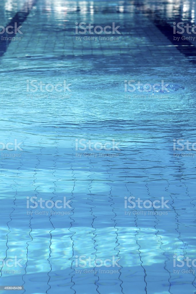 Sun reflections in pool water from sideview royalty-free stock photo