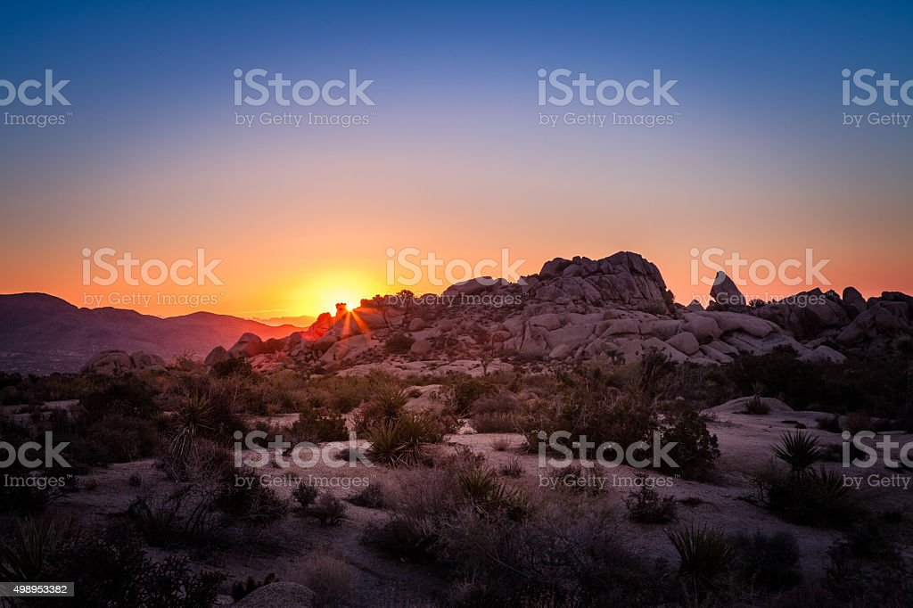 Sun Rise Over Boulder Formation In Joshua Tree National Park royalty-free stock photo