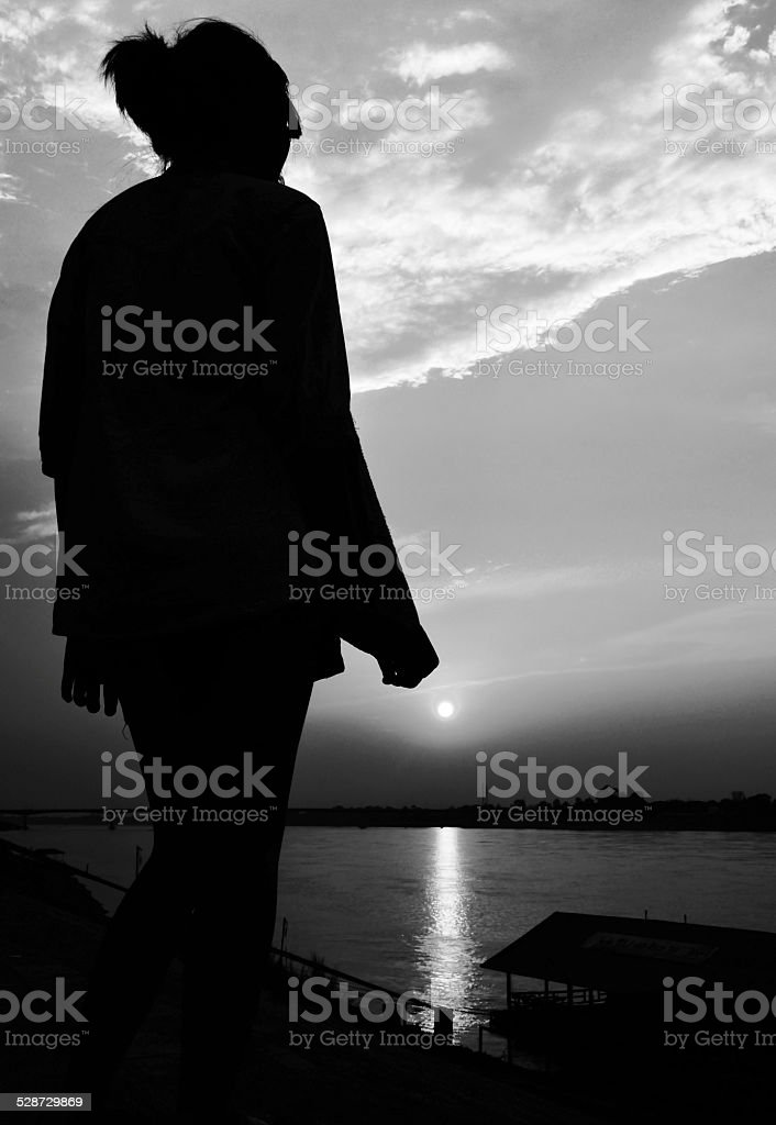 sun rise with girl siluate scene abstract stock photo