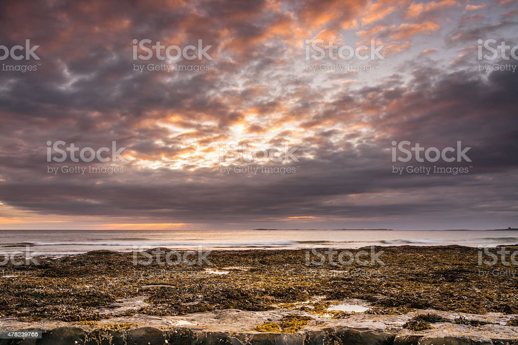 Sun rises above Farne Islands stock photo
