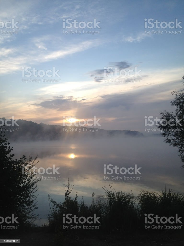sun rises and reflects stock photo