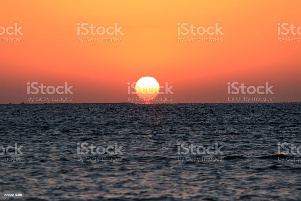 Sun Rises From The Sea stock photo