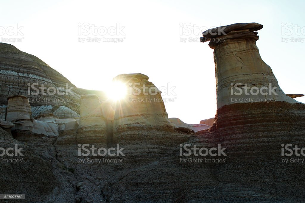 Sun Rises on Drumheller Hoodoos stock photo