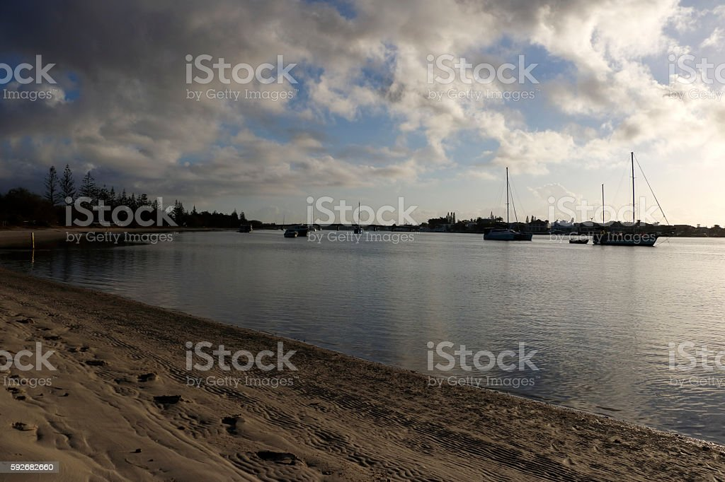 Sun Rising and Casting Light on Boats and Islands stock photo