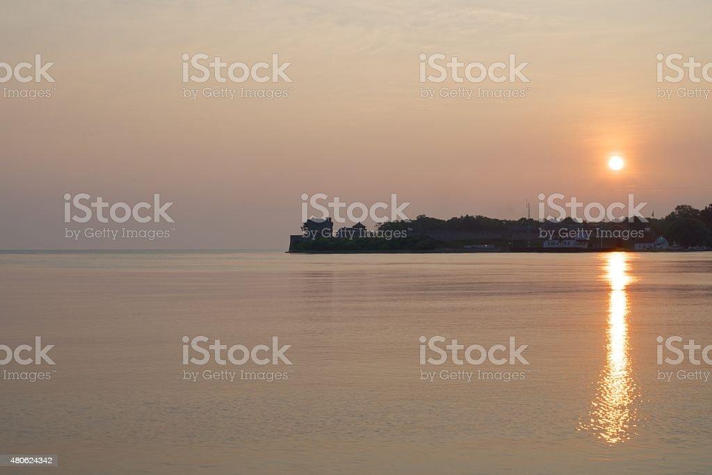 Sun rising behind Fort Niagara viewed across the Niagara River stock photo