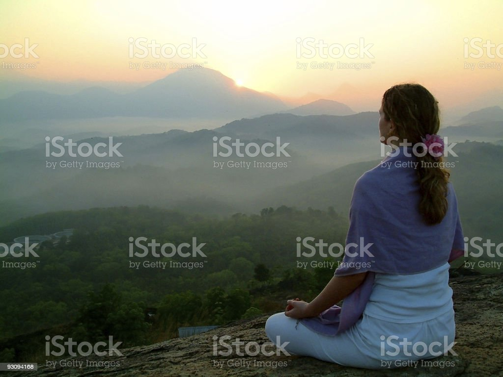 sun rising meditation stock photo