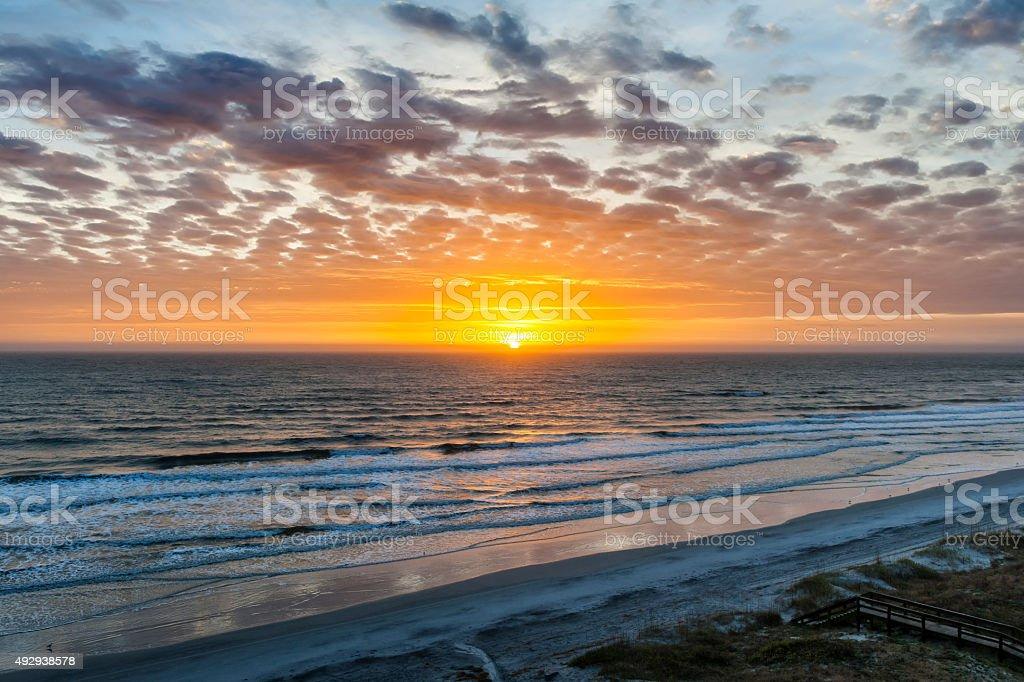 Sun rising over Atlantic stock photo