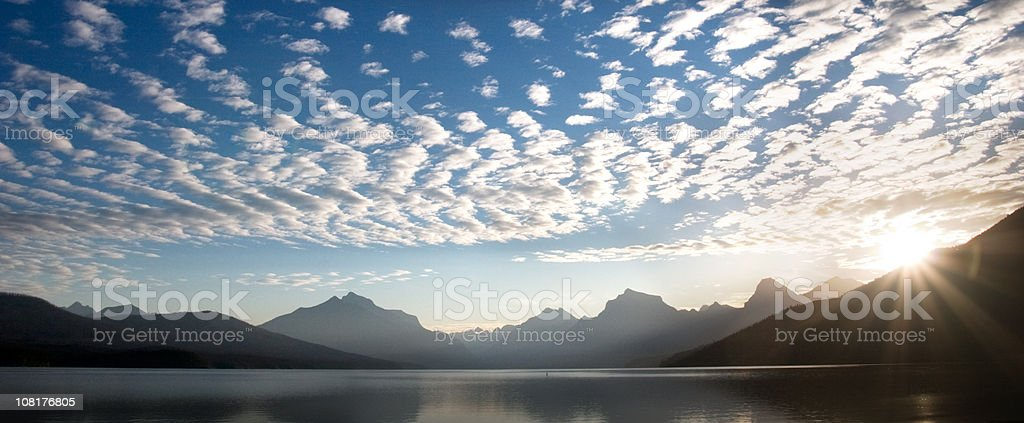 Sun Rising Over Mountains and Lake stock photo