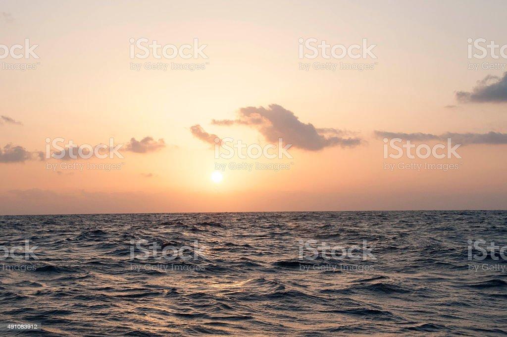Sun rising over the Ocean stock photo
